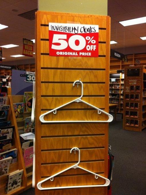 "Closing Borders displays empty hangers with the sign ""Invisibility Cloaks: 50 Percent Off"""